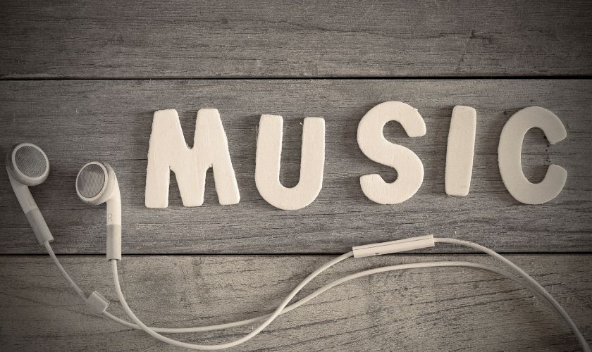 The word music with ear buds
